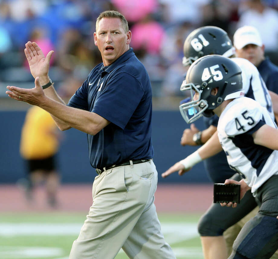 Champion coach Keith Kaiser encourages his players as Tivy hosts Champion at Antler Stadium on October 2, 2015. Photo: Tom Reel / San Antonio Express-News