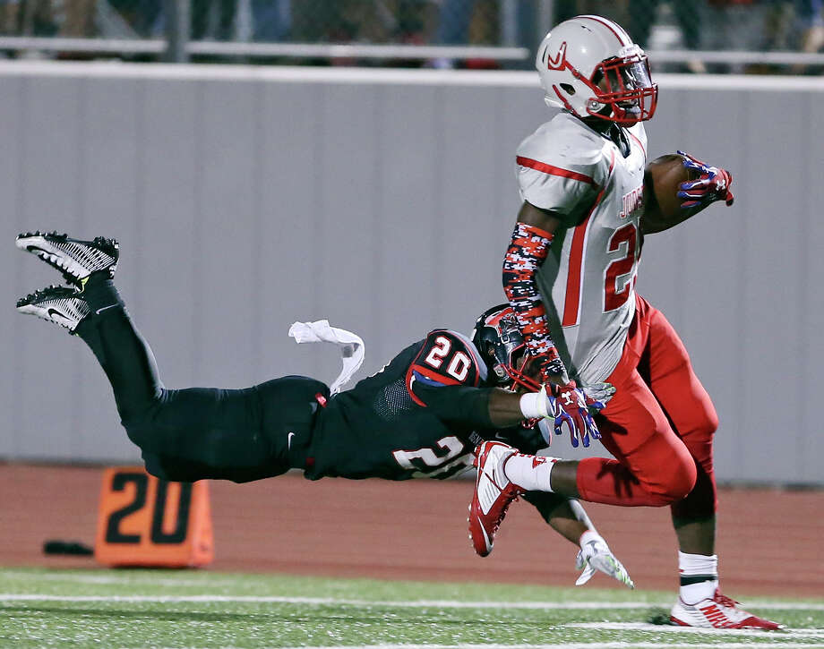 Judson's Dreshon Govan heads to the end zone for a touchdown around the tackle of Wagner's Xavier McKinnies during second half action Friday Oct. 2, 2015 at D.W. Rutledge Stadium. Judson won 47-27. Photo: Edward A. Ornelas, Staff / San Antonio Express-News / © 2015 San Antonio Express-News