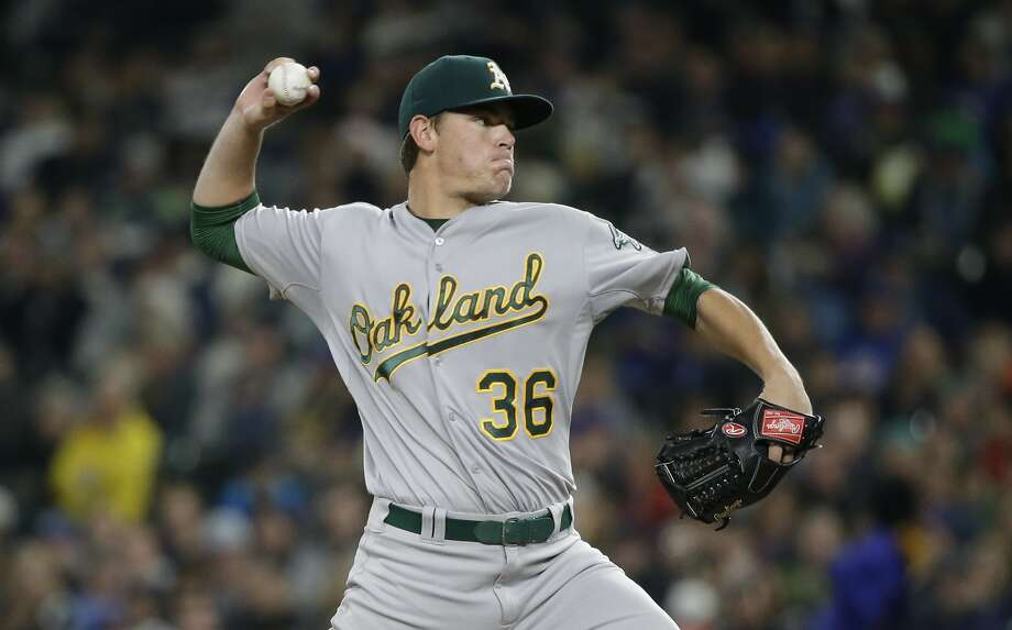 Oakland Athletics starting pitcher Aaron Brooks in action against the Seattle Mariners in a baseball game Friday, Oct. 2, 2015, in Seattle. Photo: Elaine Thompson, Associated Press