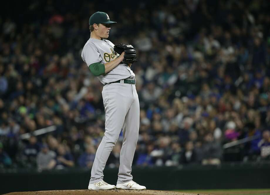Oakland Athletics starting pitcher Aaron Brooks in action against the Seattle Mariners in a baseball game Friday, Oct. 2, 2015, in Seattle. (AP Photo/Elaine Thompson) Photo: Elaine Thompson, Associated Press