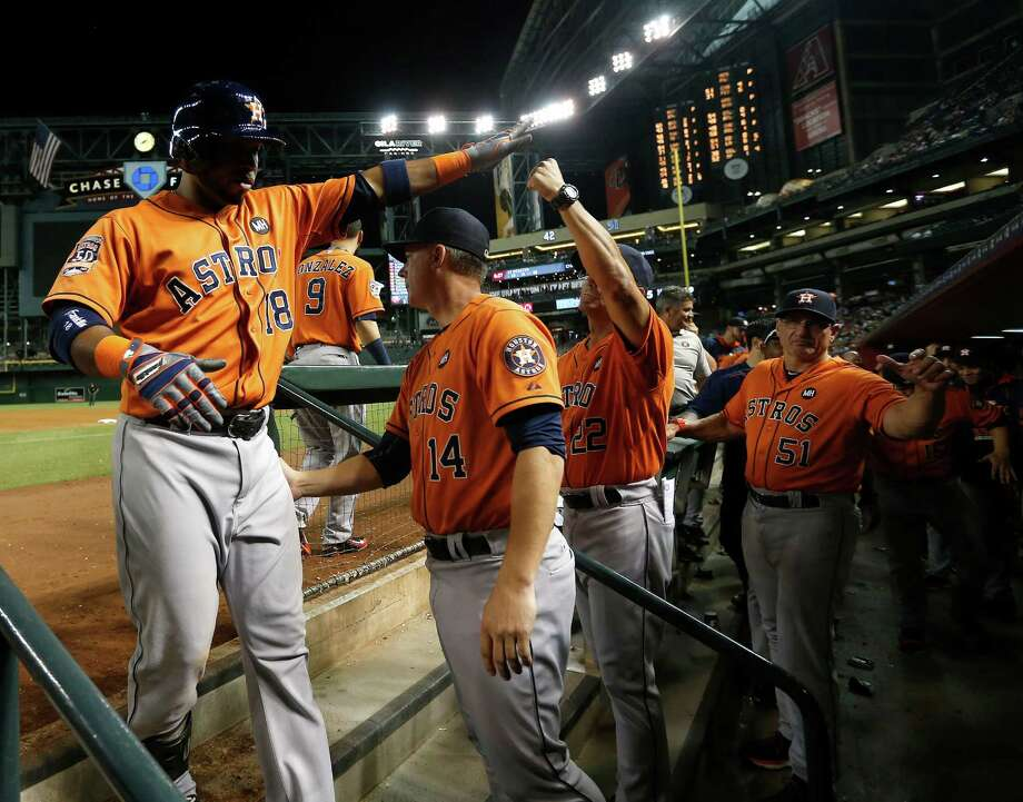 The Astros' bats were out in force Friday, with Luis Valbuena, left, providing one of four home runs on the way to a franchise record for runs scored in a 21-5 victory over the Diamondbacks at Chase Field in Phoenix. Photo: Karen Warren, Staff / © 2015 Houston Chronicle