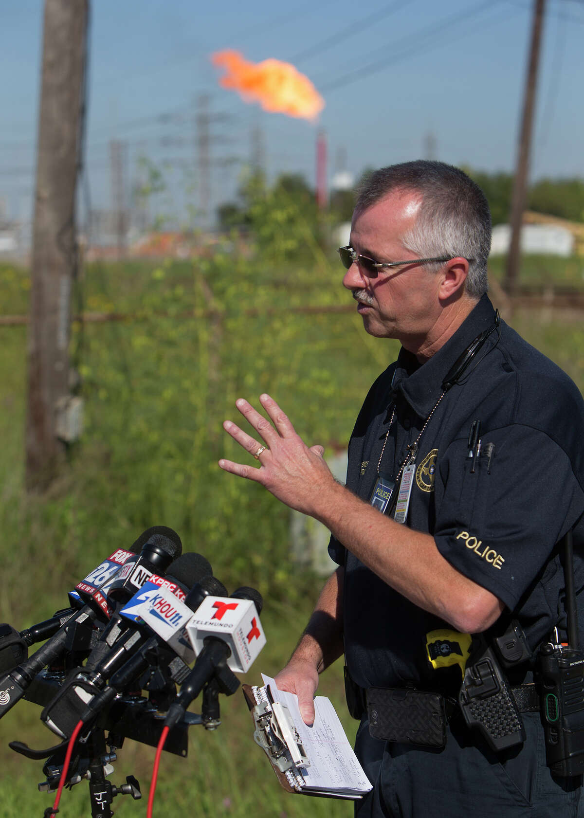 Capt. Dean Hensley of the Harris County Fire Marshal's Office speaks to the media during a news conference after four people were injured in a plant explosion at Sun Edison chemical plant in Pasadena, Friday, Oct. 2, 2015.