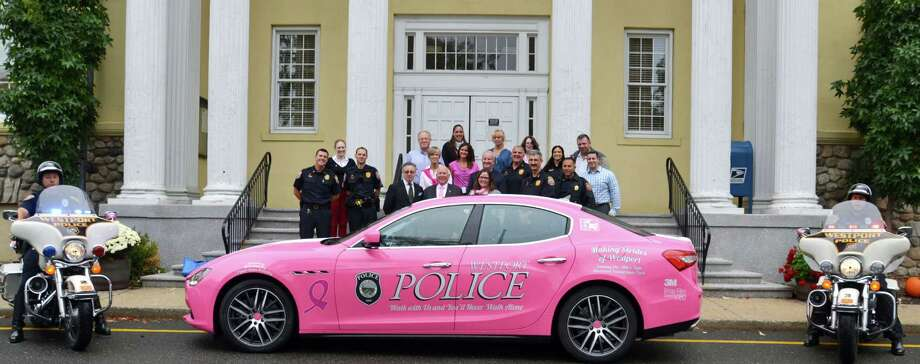 A pink Maserati on loan to police, shown here in front of Town Hall, will be used to promote breast cancer awareness around town during October. Photo: Contributed / Contributed Photo / Westport News