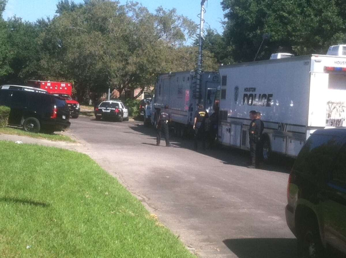 Swat scene Saturday morning at condominium where police fired gunshots when a man pointed a gun at them in southeast Houston.