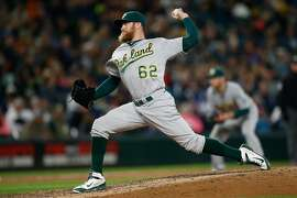 SEATTLE, WA - OCTOBER 02:  Relief pitcher Sean Doolittle #62 of the Oakland Athletics pitches against the Seattle Mariners in the ninth inning at Safeco Field on October 2, 2015 in Seattle, Washington.  (Photo by Otto Greule Jr/Getty Images)