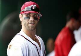 Washington Nationals right fielder Bryce Harper (34) pauses in the dugout before a baseball game against the San Francisco Giants at Nationals Park, Saturday, July 4, 2015, in Washington. (AP Photo/Alex Brandon)