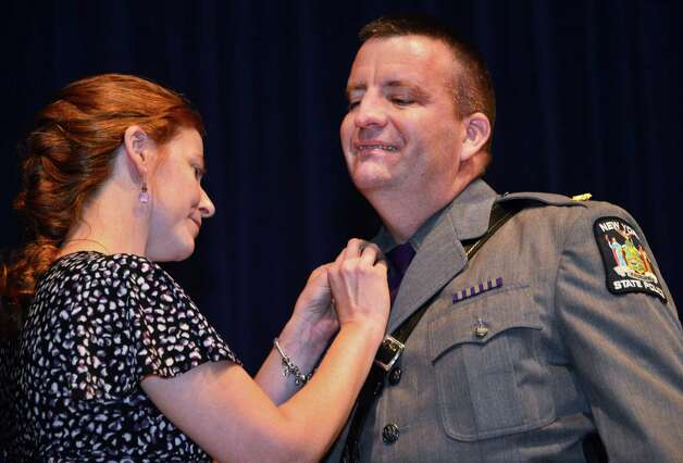 """State Police Maj. Timothy Munro, pictured here in 2013 at a ceremony honoring his assigment at the State Police crime lab, said the """"reputation and the believability"""" of the agency was at stake when he directed an internal investigation into allegations that forensic scientists cheated on a training exam. (John Carl D'Annibale / Times Union) Photo: John Carl D'Annibale / 00024294A"""