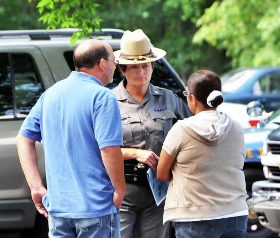 NY State Police Lt. Nancy Poulin speaks to unidentified family members of a man thought to be missing in the Pine Bush Preserve in Albany Friday afternoon August 6, 2010.  (John Carl D'Annibale / Times Union) Photo: John Carl D'Annibale