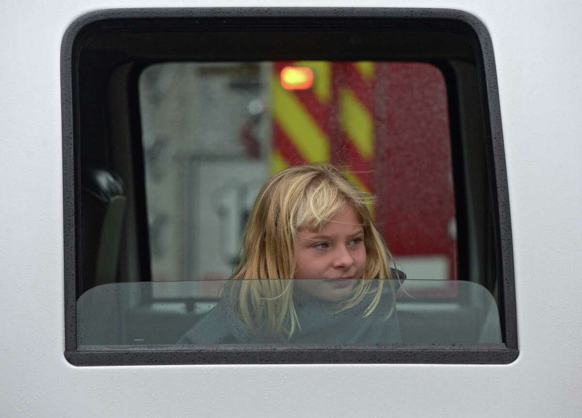 Taylor Rongetti, 9, of Danbury, watches a demonstration from the inside of a fire truck during Home Depot Fire Safety Day, at the Danbury store. Rongetti's father Chief Anthony Rongetti was taking part in a demonstration. Saturday, October 3, 2015, in Danbury, Conn.