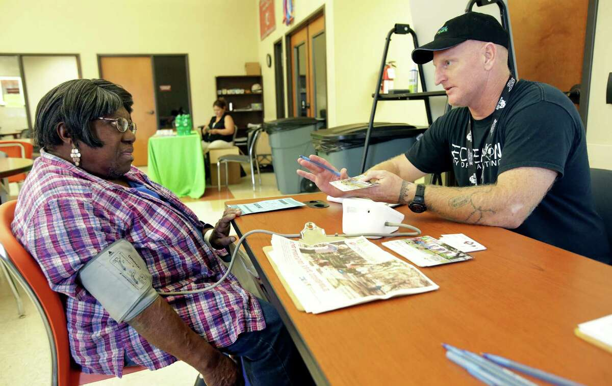 Vivian Moreland is assisted by San Antonio Parks and Recreation instructor Bruce Wayne Kuker in getting her blood pressure tested as the San Antonio Eastside Promise Zone offers a Promise Zone to Health event with free health screenings for residents and their children on November 5, 2015. The event was conducted at the senior center at 1751 South W.W. White Road.