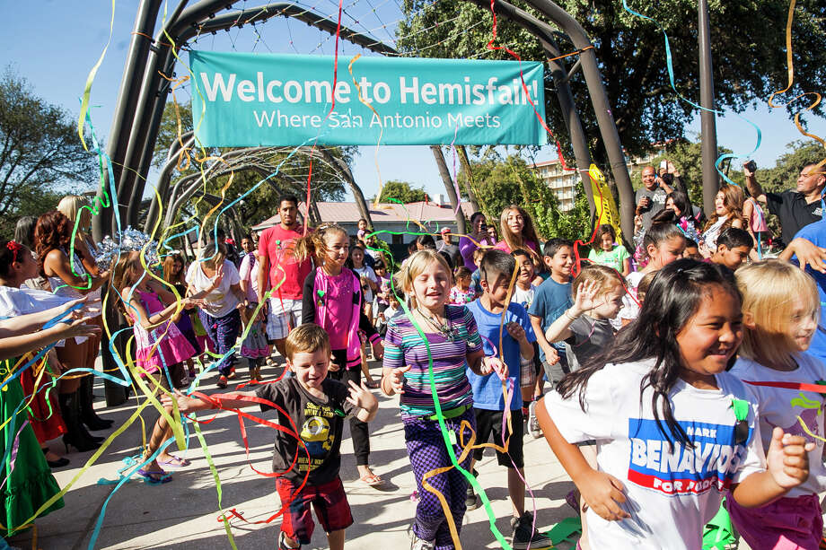 Children run through a banner kicking off the ribbon cutting ceremony at Yanaguana Garden Saturday Oct. 3, 2015 at Hemisfair Park. Yanaguana Garden is the first of three phases in HemisfairÕs relaunch expected to open in the next few years. / Julysa Sosa For the San Antonio Express-News