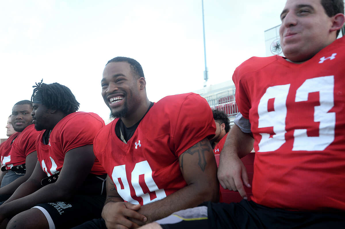 Lamar University defensive lineman Larance Hale (left) laughs as he jokes on the side with teammate William Wowkanyn during practice at Provost Umphrey Stadium Tuesday. Hale may be all business on the field, but on the sidelines, his outgoing and quirky personality shines. He jokingly refers to himself as the