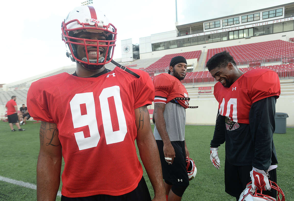 Lamar University defensive lineman Larance Hale cracks up teammates, including Shawn Jones (right) during practice at Provost Umphrey Stadium Tuesday. Hale may be all business on the field, but on the sidelines, his outgoing and quirky personality shines. He jokingly refers to himself as the