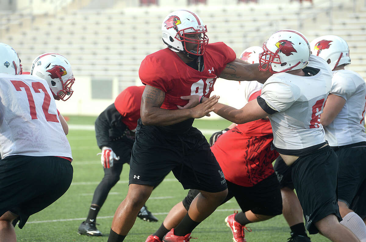 Lamar University defensive lineman Larance Hale blocks during practice at Provost Umphrey Stadium Tuesday. Hale may be all business on the field, but on the sidelines, his outgoing and quirky personality shines. He jokingly refers to himself as the