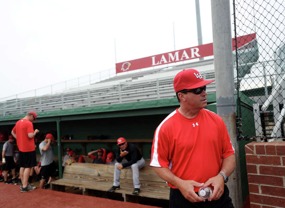 Coach Jim Ricklefsen stands near the dugout before practice Tuesday. The Lamar University Cardinals baseball team practiced Tuesday afternoon at Vincent-Beck Stadium. Photo taken Tuesday 5/13/14 Jake Daniels/@JakeD_in_SETX   Manditory Credit, No Sales, Mags Out, TV OUT, Web: AP Members Only Photo: Jake Daniels / ©2014 The Beaumont Enterprise/Jake Daniels