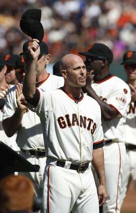 San Francisco Giants pitcher Tim Hudson waves during a ceremony commemorating his career before a baseball game between the San Francisco Giants and the Colorado Rockies, Saturday, Oct. 3, 2015, in San Francisco.  (AP Photo/George Nikitin)