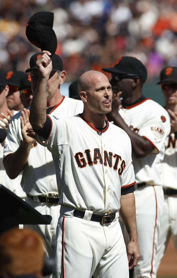 San Francisco Giants pitcher Tim Hudson waves during a ceremony commemorating his career before a baseball game between the San Francisco Giants and the Colorado Rockies, Saturday, Oct. 3, 2015, in San Francisco.  (AP Photo/George Nikitin) Photo: George Nikitin, Associated Press