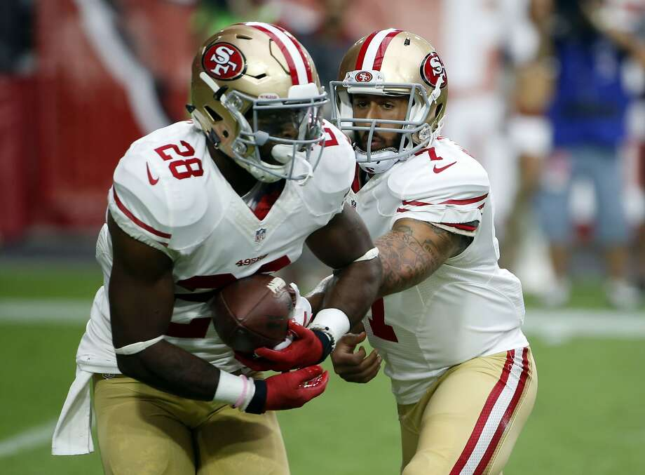 The 49ers' plans Sunday should feature a lot of Carlos Hyde (28) and quarterback Colin Kaepernick, who has averaged 100.3 rushing yards in three career starts against Green Bay. Photo: Ross D. Franklin, Associated Press