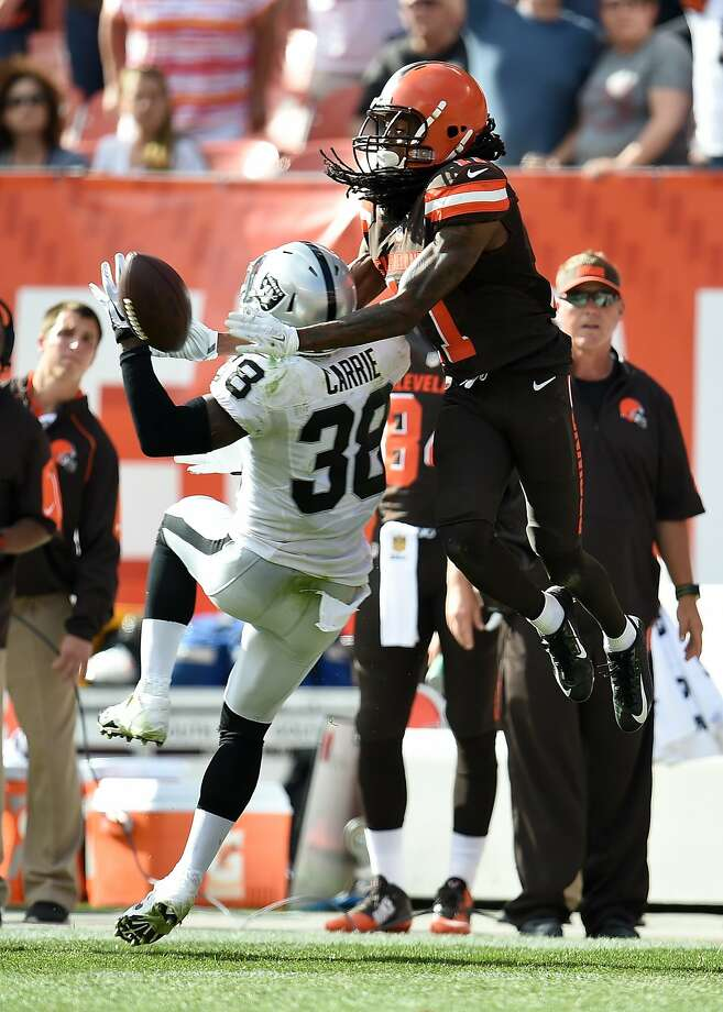 "Cornerback TJ Carrie, breaking up a pass for Travis Benjamin in Cleveland, says the Raiders have ""a mind-set of success."" Photo: Jason Miller, Getty Images"