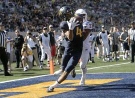 Cal's Kenny Lawler, 4 makes a one handed touchdown catch near the end of the first quarter, covered by Washington's Marcellus Pippins, 27, as the California Bears take on the Washington State Cougars at Memorial Stadium in Berkeley, Calif., on Sat. October 3, 2015.