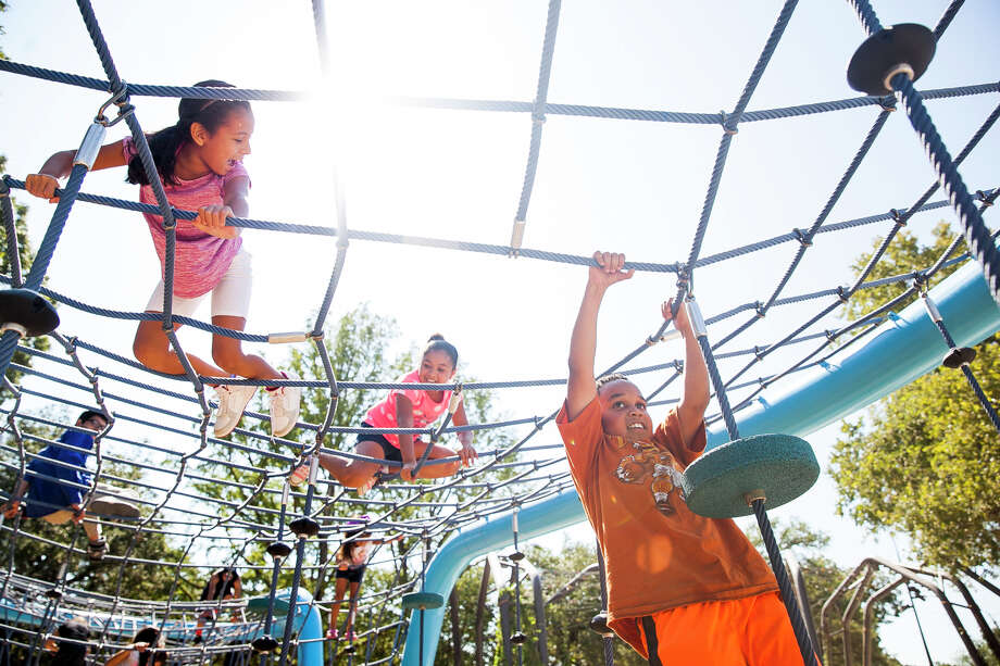 Christian Nixon, 8, plays on equipment during the official opening of Yanaguana Garden at Hemisfair. The playground is the first phase of the multimillion-dollar relaunch of the downtown park that was the site of HemisFair '68. Photo: Photos By Julysa Sosa /For The San Antonio Express-News / Julysa Sosa For the San Antonio Express-News