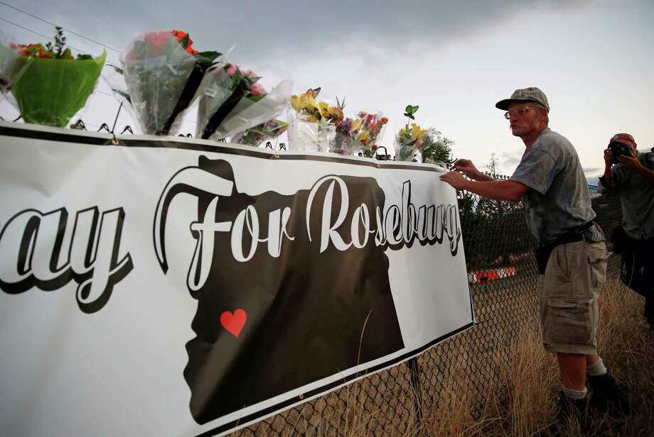 Along with the entire Roseburg, Ore., community, Michael Garwood honored friends and family killed during one of the deadliest school shootings in years.  Photo: John Locher, STF / AP