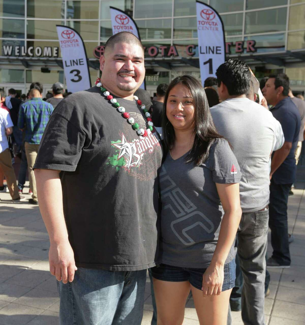 Fans pose for a photo before UFC 192 at the Toyota Center Saturday, Oct. 3, 2015, in Houston.