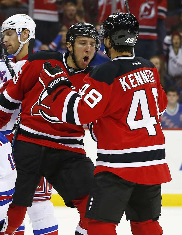 New Jersey Devils center Stefan Matteau celebrates with teammate center Tyler Kennedy (48) after scoring a goal against the New York Rangers during the second period in an NHL preseason hockey game in Newark, N.J., Saturday, Sept. 26, 2015. (AP Photo/Rich Schultz) ORG XMIT: NJRS103 Photo: RICH SCHULTZ / FR27227 AP