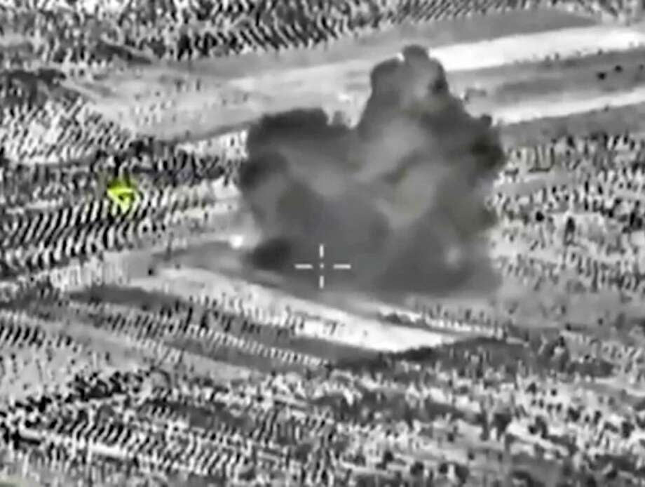 Footage taken from the Russian Defense Ministry official website on Friday shows an attack made from a fighter jet in Syria. Photo: HOGP / Russian Defense Ministry Press S