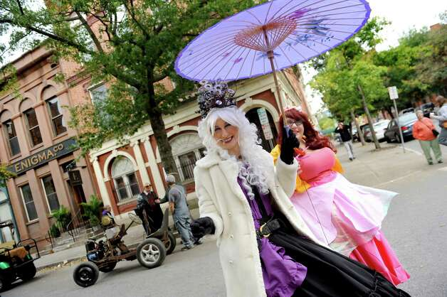 Jen Wicks of Troy as Queen Mab, center, and Amanda Furfaro as Fizzie the Fairy stroll through the streets during the Enchanted City steampunk street festival on Saturday, Oct. 3, 2015, in Troy, N.Y. The family-friendly event offered music, games, performance, food and fantasy. (Cindy Schultz / Times Union) Photo: Cindy Schultz / 10033593A