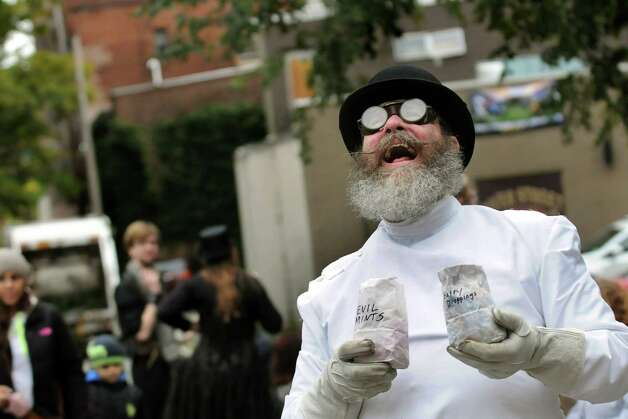 Dr. Irritation, also known as Eric Stott of Albany, offers evil mints and fairy droppings to passersby during the Enchanted City steampunk street festival on Saturday, Oct. 3, 2015, in Troy, N.Y. The family-friendly event offered music, games, performance, food and fantasy. (Cindy Schultz / Times Union) Photo: Cindy Schultz / 10033593A