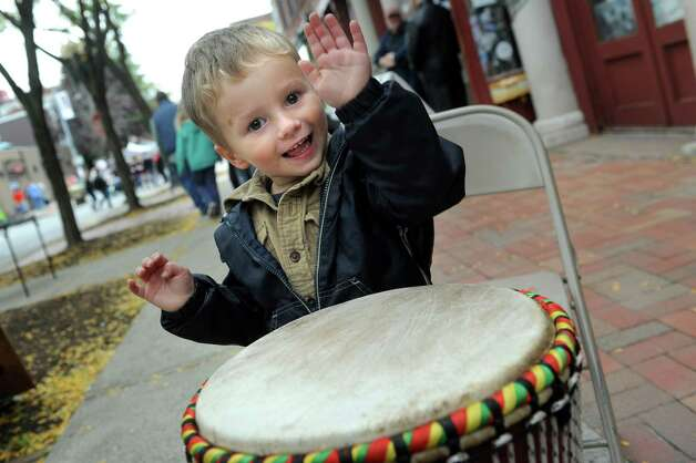 Evan Bouchard, 3, of Mechanicville beats on an African drum during the Enchanted City steampunk street festival on Saturday, Oct. 3, 2015, in Troy, N.Y. The family-friendly event offered music, games, performance, food and fantasy. (Cindy Schultz / Times Union) Photo: Cindy Schultz / 10033593A