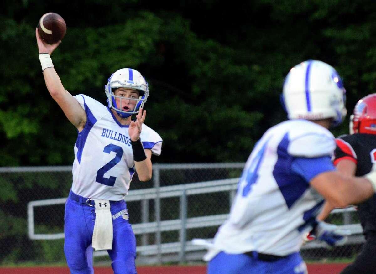 Bunnell QB Adam Wojenski throws a pass, during high school football action against Masuk in Monroe, Conn. on Friday Sept. 11, 2015.