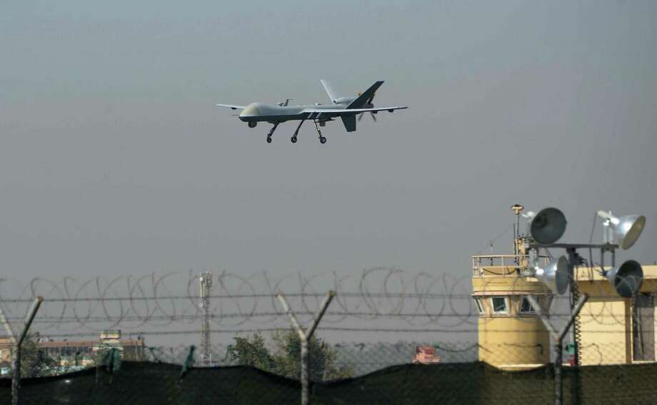A U.S. military drone lands at Afghanistan's Jalalabad Airport. American-trained security forces there have been  less than effective, and similar poor results are occurring in Syria and Iraq. In some cases, such troops have run away, refused to engage the enemy or have defected. Photo: NOORULLAH SHIRZADA, Stringer / AFP