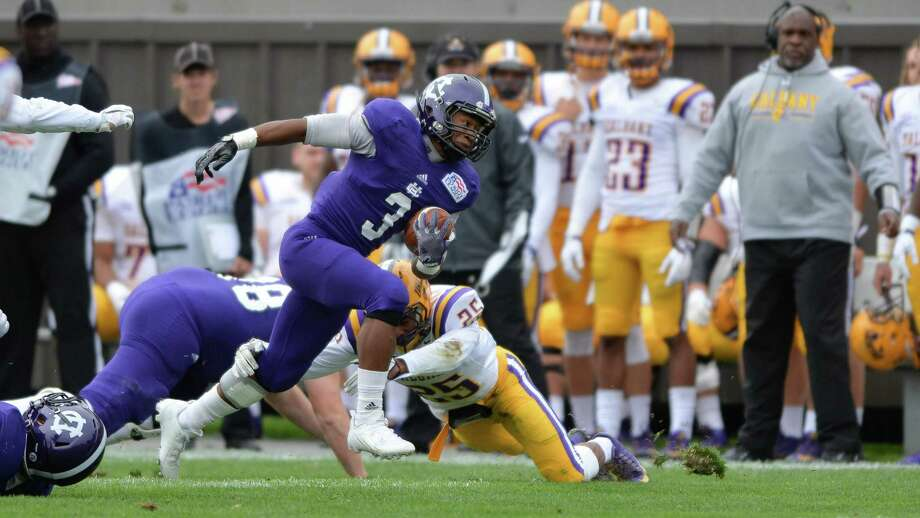 Holy Cross running back Diquan Walker eludes a tackle attempt during Saturday's game against the University at Albany. (Mark Seliger / Holy Cross) Photo: Mark Seliger / Mark Seliger