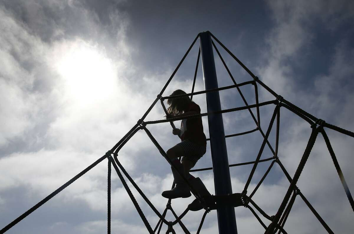 Second-grader Grace Wofsy reaches new heights of a play structure at Commodore Sloat Elementary School in San Francisco, Calif. on Saturday, Oct. 3, 2015. The playground at the school joins a list of others citywide that will be open on weekends as part of the Shared Schoolyard project.