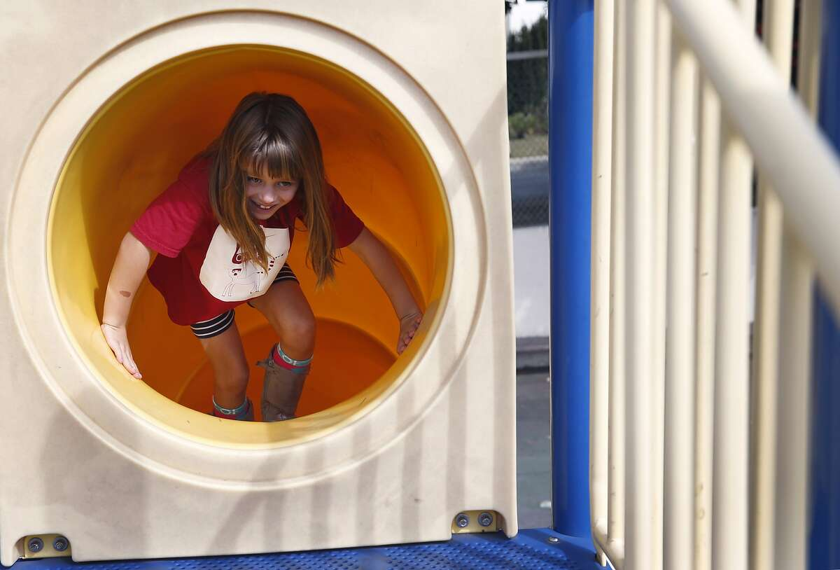 Second-grader Grace Wofsy emerges from the top end of a slide at Commodore Sloat Elementary School in San Francisco, Calif. on Saturday, Oct. 3, 2015. The playground at the school joins a list of others citywide that will be open on weekends as part of the Shared Schoolyard project.