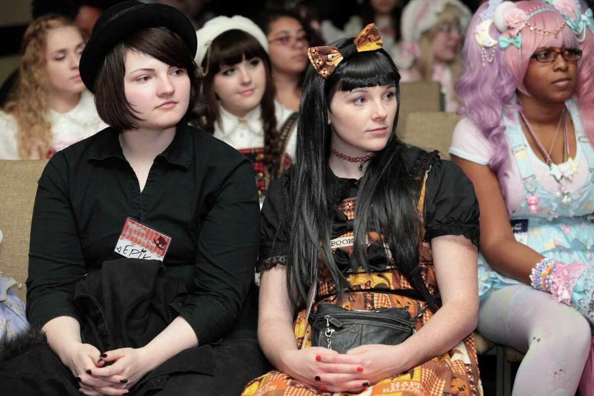 Epik Asia, left, and Carolyn Maclean, both of Hudson, MA, watch a fashion show at RuffleCon at the Sheraton in Stamford, Conn. on Saturday, October 3, 2015.