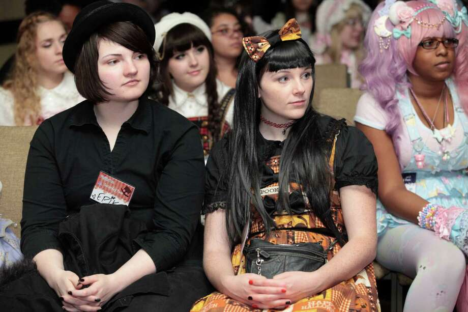 Epik Asia, left, and Carolyn Maclean, both of Hudson, MA, watch a fashion show at RuffleCon at the Sheraton in Stamford, Conn. on Saturday, October 3, 2015. Photo: BK Angeletti, For Hearst Connecticut Media / Connecticut Post freelance B.K. Angeletti