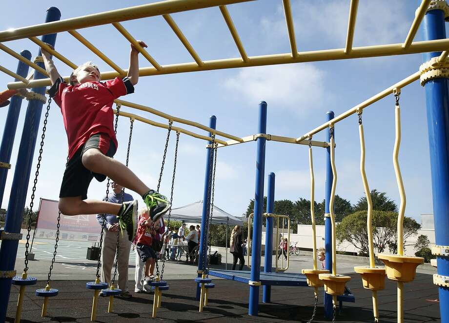 Jack Farrell, 7, climbs across a play structure at Commodore Sloat Elementary School in San Francisco, Calif. on Saturday, Oct. 3, 2015. The playground at the school joins a list of others citywide that will be open on weekends as part of the Shared Schoolyard project. Photo: Paul Chinn, The Chronicle