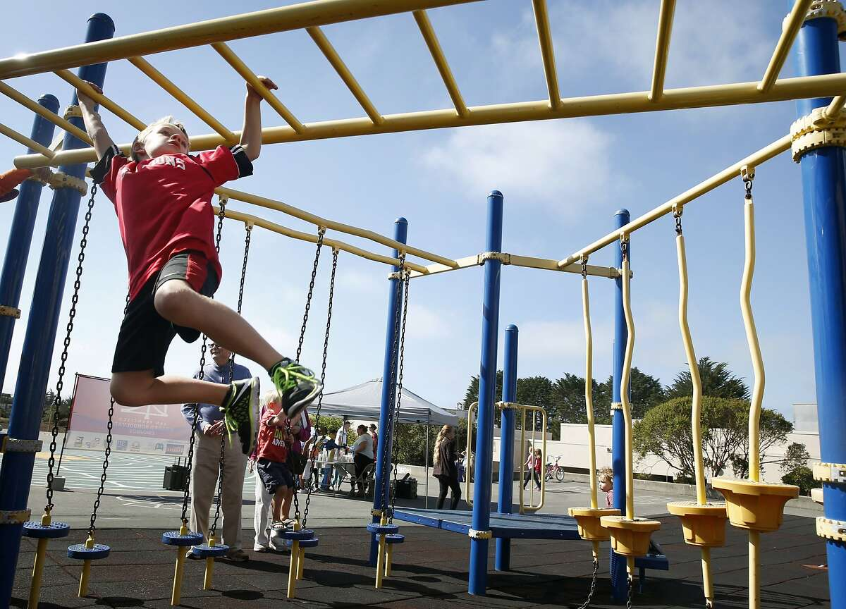 Jack Farrell, 7, climbs across a play structure at Commodore Sloat Elementary School in San Francisco, Calif. on Saturday, Oct. 3, 2015. The playground at the school joins a list of others citywide that will be open on weekends as part of the Shared Schoolyard project.