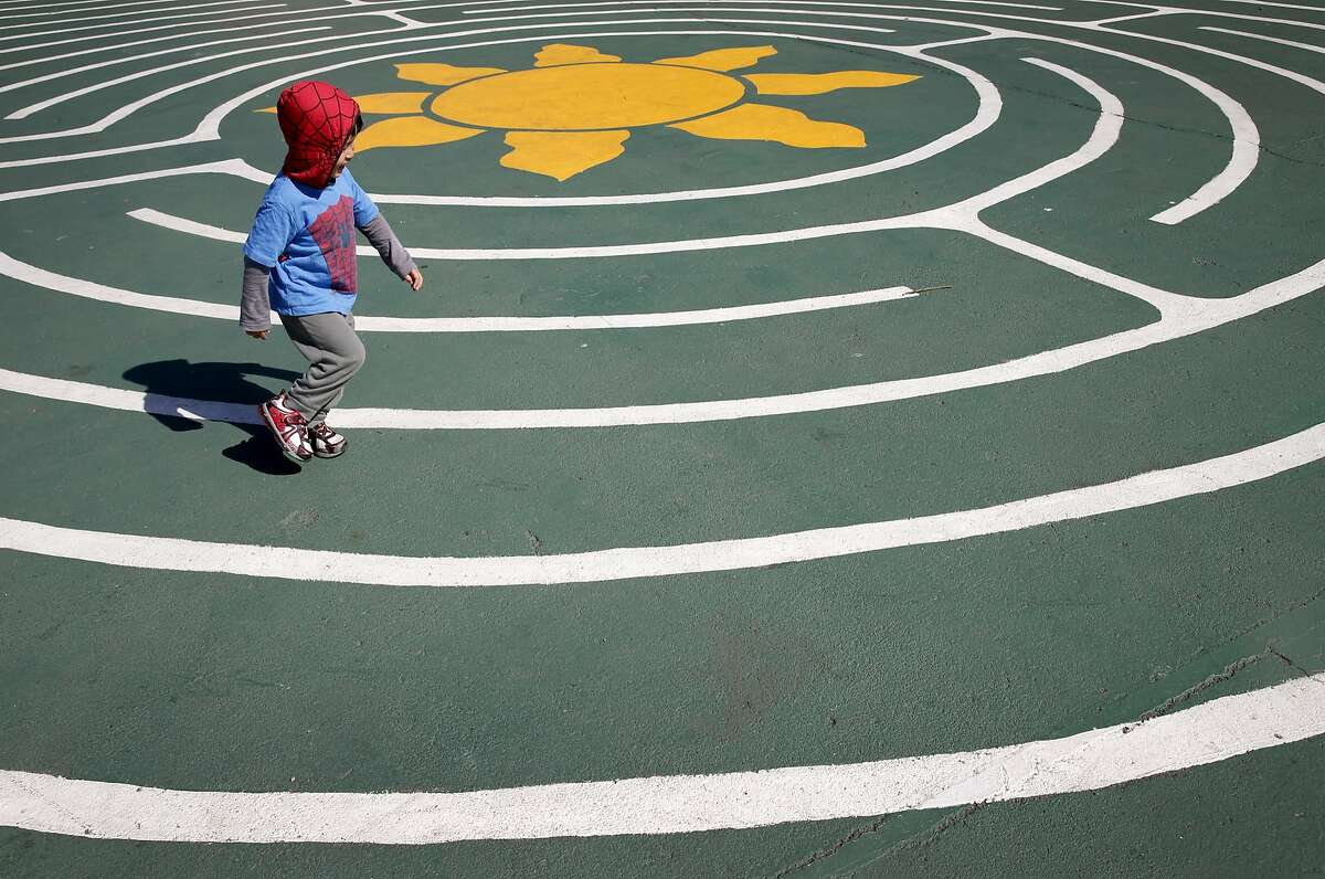 Three-year-old Brandon Mak runs across the labyrinth at Commodore Sloat Elementary School in San Francisco, Calif. on Saturday, Oct. 3, 2015. The playground at the school joins a list of others citywide that will be open on weekends as part of the Shared Schoolyard project.