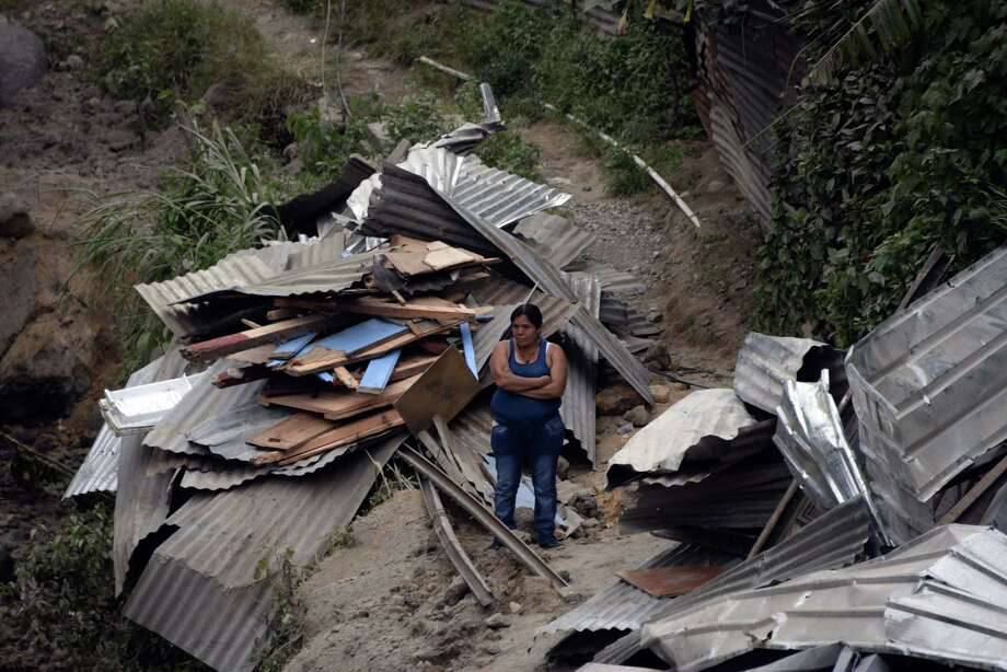 A landslide late Thursday covered part of the village of El Cambray II, 10 miles east of Guatemala City. Officials say the death toll is at 56 and still rising. Photo: JOHAN ORDONEZ, Stringer / AFP
