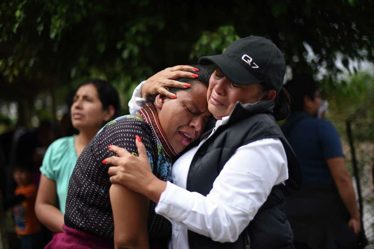 Women cry outside a provisional morgue in the village of El Cambray II, in Santa Catarina Pinula municipality, some 15 km east of Guatemala City, on October 3, 2015 after a landslide late Thursday struck the village. At least 32 people were killed and about 600 others missing following a landslide that damaged some 125 homes on the outskirts of the Guatemalan capital, an official said Friday, noting that the death toll could rise as rescue efforts continue. AFP PHOTO / JOHAN ORDONEZJOHAN ORDONEZ/AFP/Getty Images