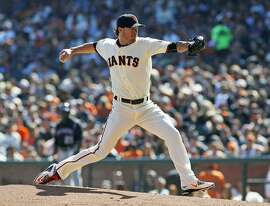 San Francisco Giants pitcher Jake Peavy throws to the Colorado Rockies during the first inning of a baseball game, Saturday, Oct. 3, 2015, in San Francisco.  (AP Photo/George Nikitin)