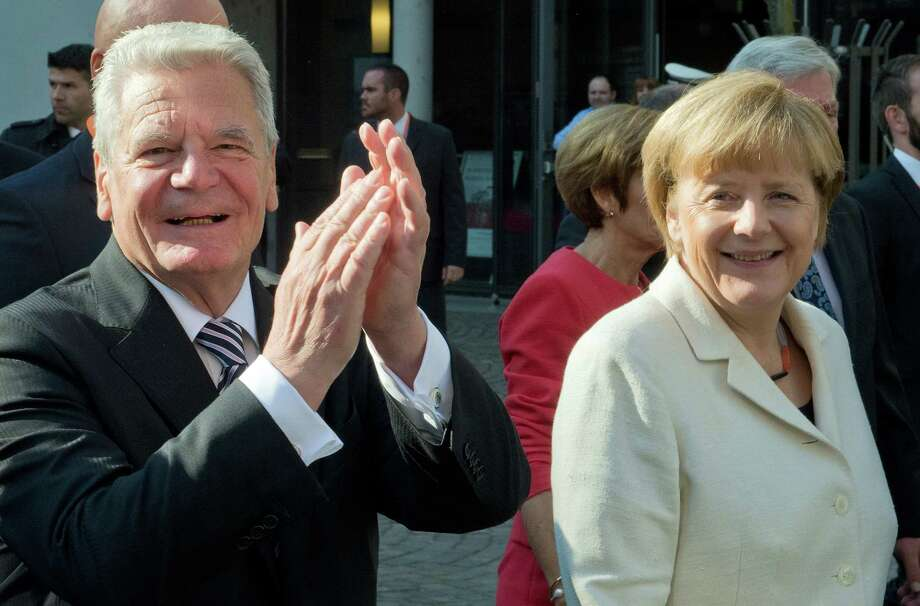 German President Joachim Gauck and Chancellor Angela Merkel, from left, walk through the city during celebrations marking the 25th anniversary of the German Unification in Frankfurt, Germany, Saturday, Oct. 3, 2015. (Boris Roessler/Pool Photo via AP)  ORG XMIT: LGL108 Photo: Boris Roessler / POOL DPA
