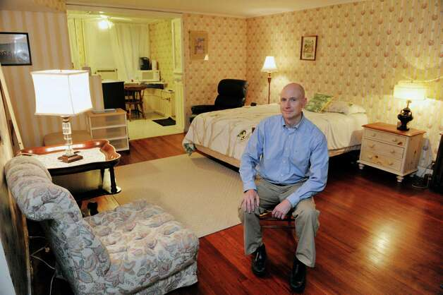 Gregg Tobin sits inside a portion of his home that he rent's out through Airbnb, on Thursday, Oct. 1, 2015, in Albany, N.Y.  (Paul Buckowski / Times Union) Photo: PAUL BUCKOWSKI / 10033576A