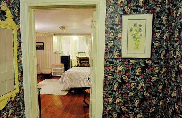 A view looking in to the bedroom and the kitchen off the bedroom in a portion of Gregg Tobin's home that he rent's out through Airbnb, seen here on Thursday, Oct. 1, 2015, in Albany, N.Y.  (Paul Buckowski / Times Union) Photo: PAUL BUCKOWSKI / 10033576A