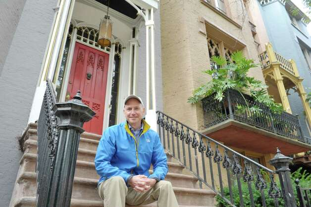 Gregg Tobin sits on the steps outside his home on Thursday, Oct. 1, 2015, in Albany, N.Y.  Tobin rent's out a portion of his home through Airbnb.  (Paul Buckowski / Times Union) Photo: PAUL BUCKOWSKI / 10033576A