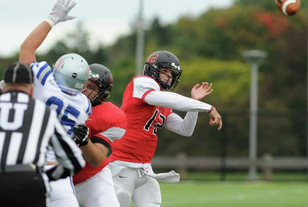 RPI quarterback Jeff Avery throws for a gain during their men's college football game against Merchant Marine on Saturday Oct. 3, 2015 in Troy , N.Y.  (Michael P. Farrell/Times Union) Photo: Michael P. Farrell / 10033574A